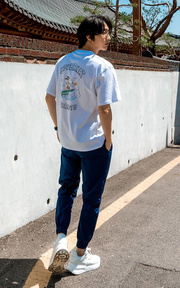 COVERNAT CXPEANUTS 70TH SURFING SNOOPY TEE WHITE的穿搭