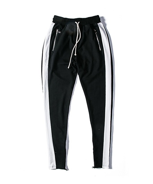 WIDE AWAKE 的 SKINNY TRACKPANTS WITH ANKLE ZIP